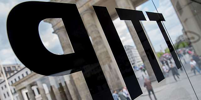 TTIP is written on a glass reading room in which Greenpeace made TTIP documents available to the public at Brandenburger Tor in Berlin, Germany, 3 May 2016. For years, the US and EU are negotiating the trade agreement TTIP. In Germany, the agreement is highly controversial. Greenpeace published so far unknown details. Photo by: Kay Nietfeld/picture-alliance/dpa/AP Images